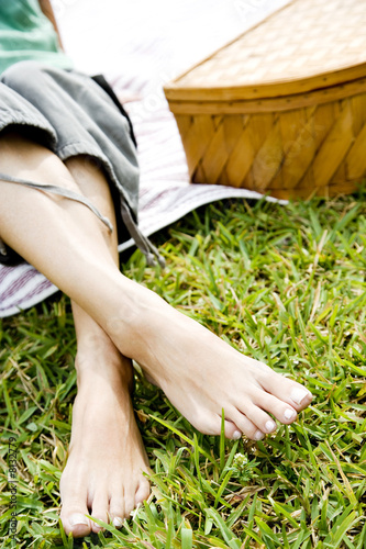 woman's bare feet crossed at the ankle