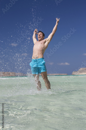 A man standing in the sea