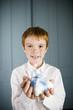 boy ginger hair holding miniature birthday cake