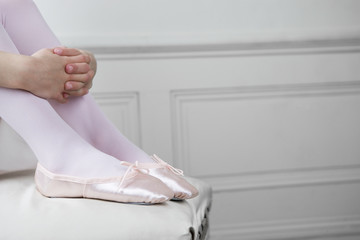 Close up of a young girls feet wearing ballet shoes