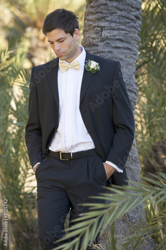 A sad bridegroom waiting for the bride