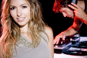 Young woman standing by the DJ