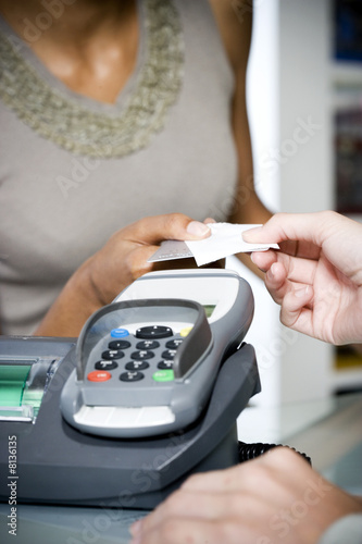 Woman taking credit card and receipt from sales assistant