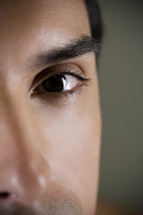 Close up of a young man's face focusing on the eye