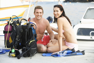 A couple checking their scuba diving equipment