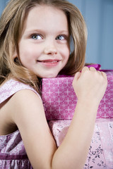 Young girl holding birthday presents