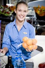 Portrait of a supermarket checkout assistant.