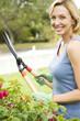 woman in the garden holding garden shears