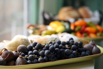 Buffet of fresh fruit, breads and muffins
