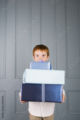 boy with ginger hair holding presents