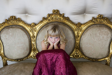 Young girl in a party dress sulking