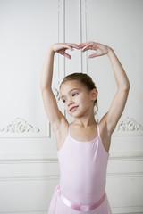 Little girl in a ballet pose