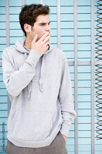 Portrait of a moody young man smoking