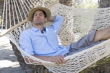 A man relaxing in a hammock