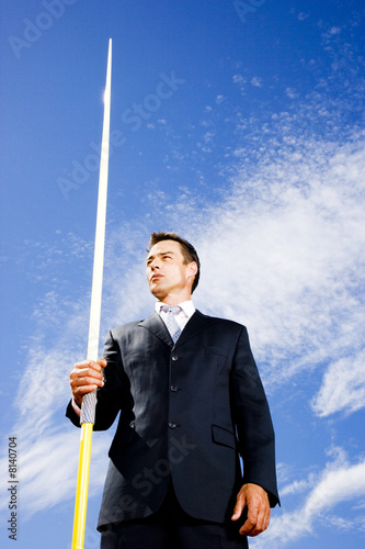 Portrait of a businessman throwing a javelin