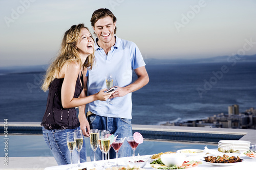 Couple sharing a joke at a party