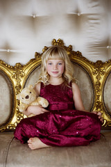 Portrait of a little girl holding a teddy bear