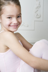 Portrait of a smiling girl in a ballet tutu