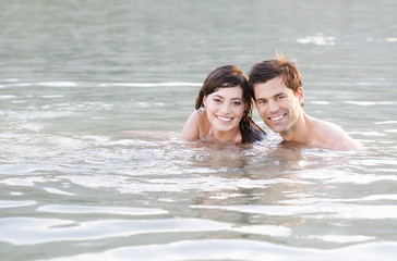 A couple swimming in a lake