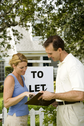 Woman consulting letting agent about property to let