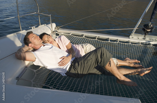 A couple lying on a catamaran