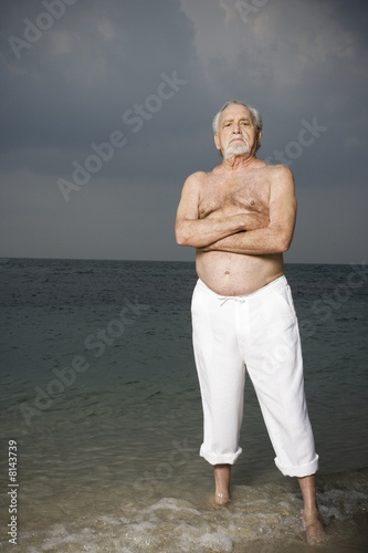 Portrait of a senior man standing in the sea