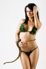 Sexy woman in bikini with a snake