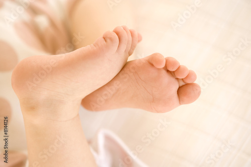 Baby girl (9-12 months), close-up of feet