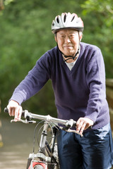 Senior asian biking