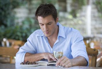 A man sitting alone in a restaurant