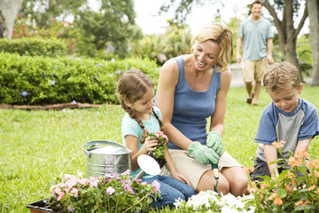 mother and children gardening