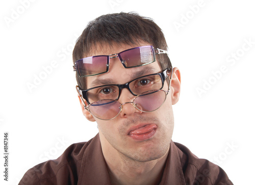 Tired young man wearing three glasses