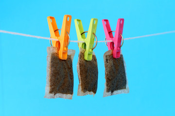 Three teabags hanging out to dry