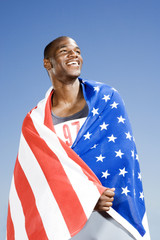 Portrait of a male athlete with US flag
