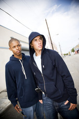 Portrait of two young street gang members