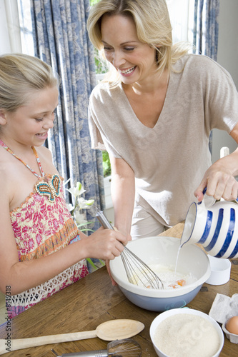 Mother and daughter (8-10) baking, elevated view