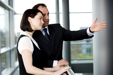 Businessman with female colleague or client in office