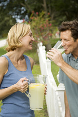 couple in garden with jug of lemonade