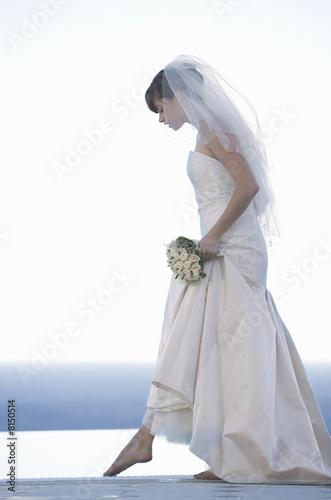 A bride walking barefoot
