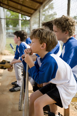 Side view little league baseball team waiting to bat