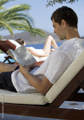 Two people relaxing in the sun