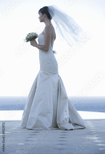 A bride waiting by a pool