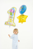 Baby boy (6-9 months) with baloons, elevated view