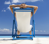 A man relaxing in a deck chair