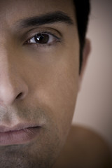 Close up of a young man's face, focusing on the eye