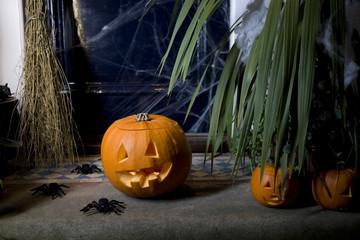 Atmospheric Hallowe'en scene - pumpkin, broomstick and spiders