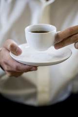 Close up of a man with an espresso cup