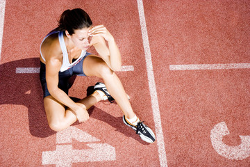 Portrait of a female athlete resting