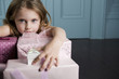 Young girl with birthday presents