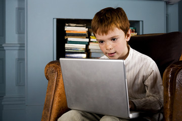 boy looking at laptop computer